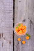 Organic fresh northern cloudberries on a wooden background — Stock Photo