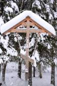 Orthodox antique handmade wooden cross in winter forest — Stock Photo