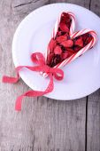 Candy cane heart symbol on white plate — Stock Photo