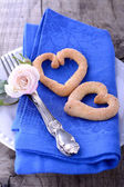 Serving with a blue napkin and homemade cookies in the shape of  heart — Stockfoto
