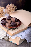 Chocolate truffles on wooden table. — Stock Photo