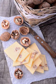 Sliced cheeses and walnuts — Stock Photo