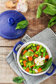 Assorted vegetables with spinach leaves — Stock Photo