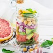 Постер, плакат: Delicious salad put into a jar for easy transport