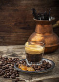 Cup of coffee in vintage with caramel brown sugar crystals — Stock Photo