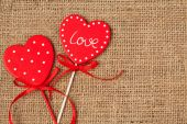 Red valentine's day hearts on vintage textile background  — Foto de Stock
