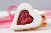 Heart shaped cookies for valentine's day with ribbons on backgro — Stock Photo