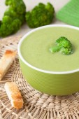 Traditional broccoli green cream soup recipe with croutons on vintage background — Stock Photo