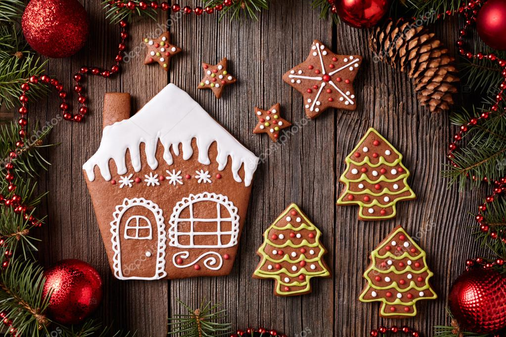 Gingerbread House Stars And Fur Trees Cookies Christmas Composition In New Year Decorations Frame On Vintage Wooden Table Background