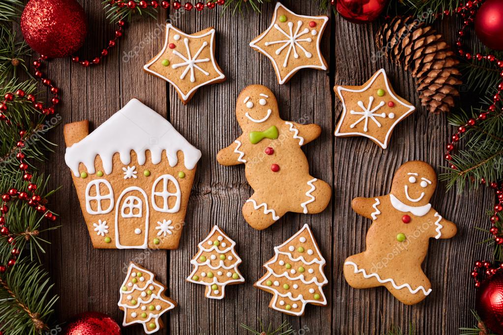 Gingerbread Man And Woman House Fir Trees Stars Cookies Composition With Christmas Decorations