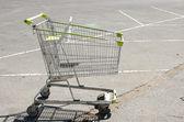 Shopping cart at parking lot — Stock Photo