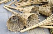 Bamboo wickerwork basket on floor near black soil — Stock Photo