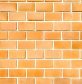 Orange ruled brick wall texture background — Stock Photo