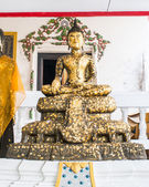 Buddha with gold leaf — Stock Photo