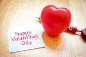Notepad with heart toy and red pen on wooden table Happy Valenti — Stock Photo