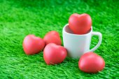 Red heart in coffee cup on grass, Love concept — Stock Photo