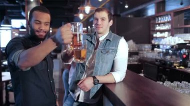 Two gay friends cheerful friends at the bar welcome their friends — Stock Video