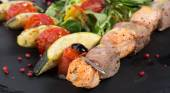 Grilled fish and vegetables with salad — ストック写真