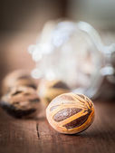 Nutmegs on a wooden table — Stockfoto