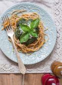 Green pesto with pasta. — Stock Photo