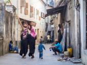 Local people walking on one of the narrow streets — Stock Photo