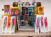 Local store selling colorful tingatinga paintings — Stock Photo