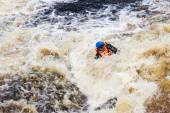 People in life jackets drowning in a turbulent river — Stock Photo