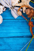 Summer theme blue background with space for advertising and maritime theme (seashells, starfish, sea knots, anchor) — Stock Photo