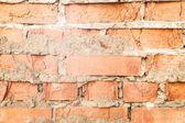 Background of old wall of red brick with clay masonry scuffed — Stock fotografie