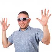 Attractive adult man with stubble in summer shirt that shows gesture on an isolated white background — Stock Photo