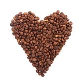 Roasted coffee laid out in the form of heart isolated on white background — Stock Photo