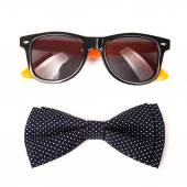 White polka dot bow tie colors stylish and trendy sunglasses isolated on white background — Stock Photo