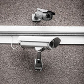 Two urban security cameras — Stock Photo