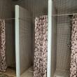 Shower rooms with shutters in the spa salon — Stock Photo #56653827