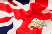 A small fee on the background of the flag of the United Kingdom — Stock Photo