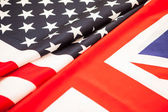 The greatness of America and Britain. Two state flag folded in h — Stock Photo
