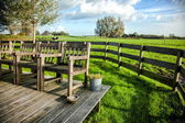 Farmhouse porch with vintage chairs against the backdrop — Stock Photo