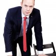 Director with a red tie leaned on the table — Stock Photo #77318586