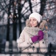 Outdoor winter closeup colorful portrait of young happy brunette. — Stock Photo #77401588