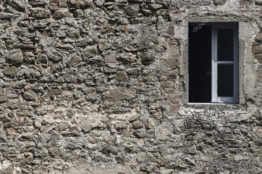 Vecchia casa di muro di mattoni di pietra con sfondo della ...