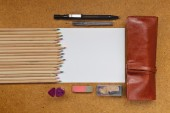 Colored pencils and paper — Stock Photo
