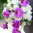 Wedding bouquet. Bouquet of fresh flowers for the wedding ceremony. Bouquet of orchids, roses and other flowers in the groom's hands closeup. — Stock Photo #53134127