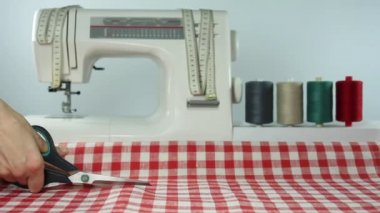 Tailor. Cutting fabric scissors. Dressmaker at work. Sewing. — Stock Video