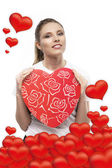 Girl with hearts — Stock Photo