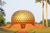 Huge golden spherical ball auroville tamil nadu india — Stock Photo
