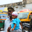 India man carrying a baby with make up — Stock Photo #61688715