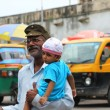India man carrying a baby with make up — Stock Photo #61688741