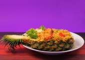 Baked rice and seafood in pineapple — Stock Photo