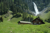 Waterfall in mountainous region — Stock Photo