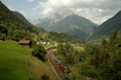 Train trafersing a Valley — Stock Photo